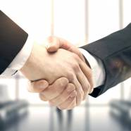 handshake on background of blured modern building